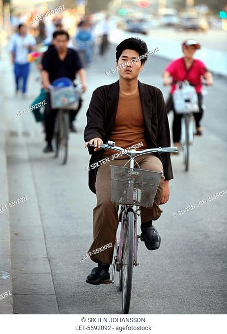 A man rides on a bicycle in Beijing in the evening. China
