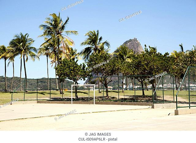 Empty basketball and soccer court in front of Sugarloaf mountain, Rio De Janeiro, Brazil