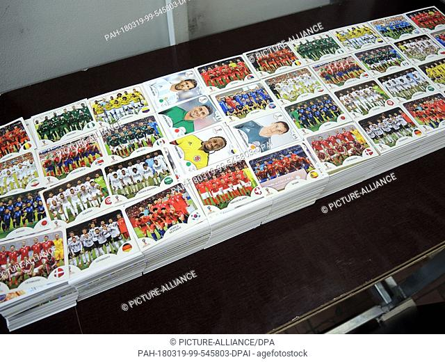 12 March 2018, Italy, Modena: Stacks of sticker sheets are stored at a Panini sticker production facility. From 27 March