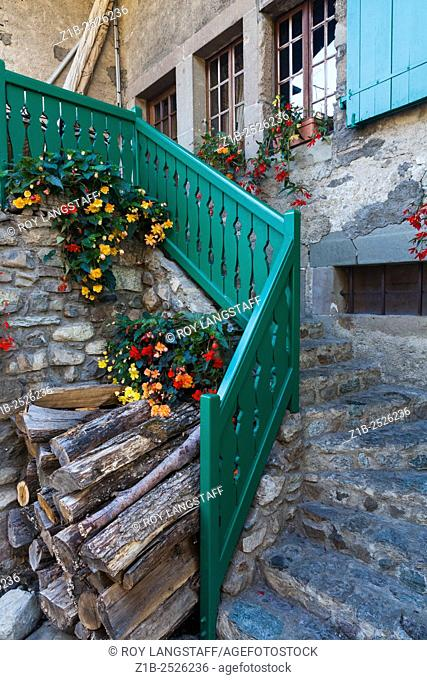 Stairway to the entrance of a private residence in the medieval village of Yvoire in France
