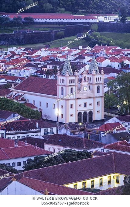 Portugal, Azores, Terceira Island, Angra do Heroismo, elevated view of the Santissimo Salvador da Se cathedral church, evening
