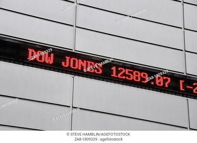 Ticker tape sign of foreign stock markets and prices for Dow Jones