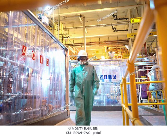 Engineer walking in acid and caustic plant in power station