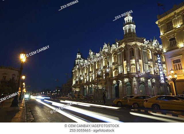 View to the Gran Teatro-Grand Theatre building and Hotel Inglaterra with car trails in the foreground in Central Havana by night, La Habana, Cuba, West Indies