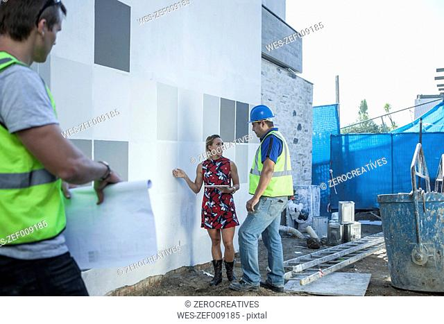 Construction worker and woman talking on construction site