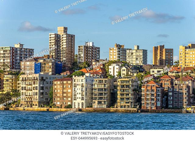 Beautiful part of Sydney Kirribilli with houses and ocean coastline, suburb of Sydney Australia. As the sun sets and casts warm golden color
