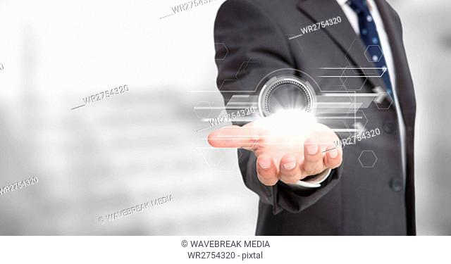 Business man with white interface and flare on hand against blurry grey stairs