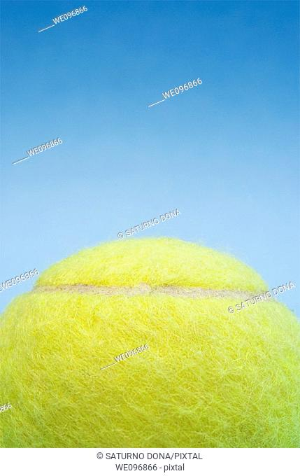 yellow tennis ball against blue sky