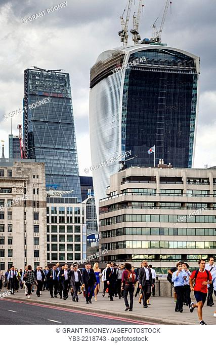 Commuters Crossing London Bridge During The Rush Hour, London, England