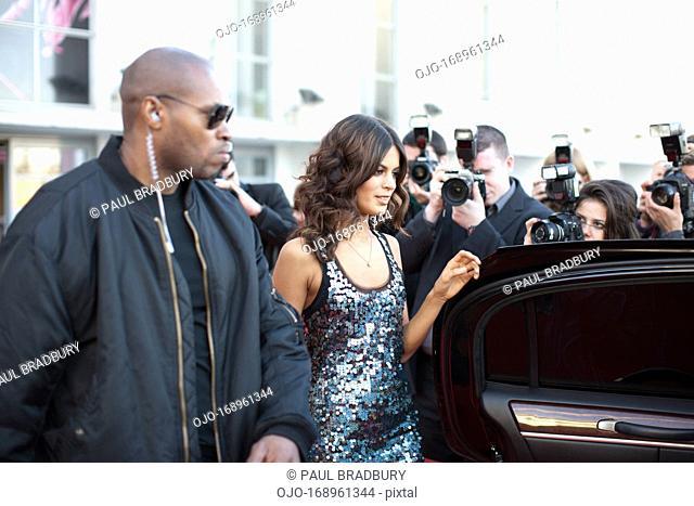Celebrity walking to car on red carpet