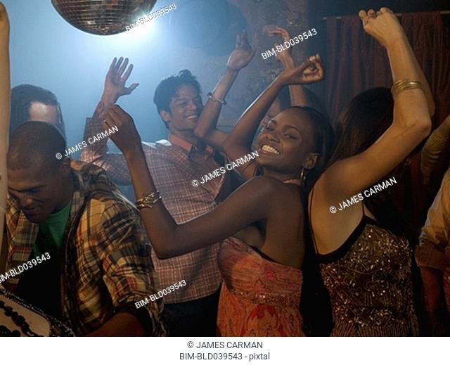 Multi-ethnic friends dancing at nightclub