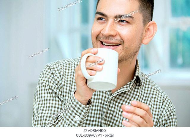 Mid adult man having coffee