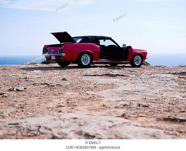 vintage car at cliffside