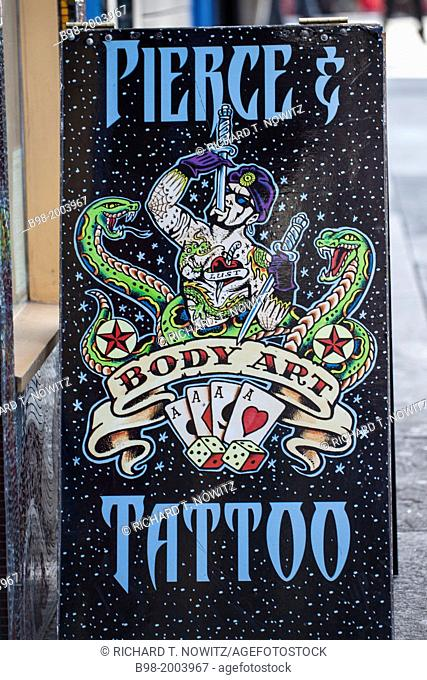 An artistic painted advertising SIGN FOR BODY PIERCING in Haight-Ashbury, center of 1960's counter culture revolution