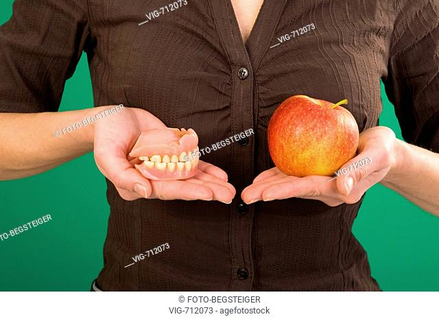 woman with false teeth and apple in hands. - 26/03/2008