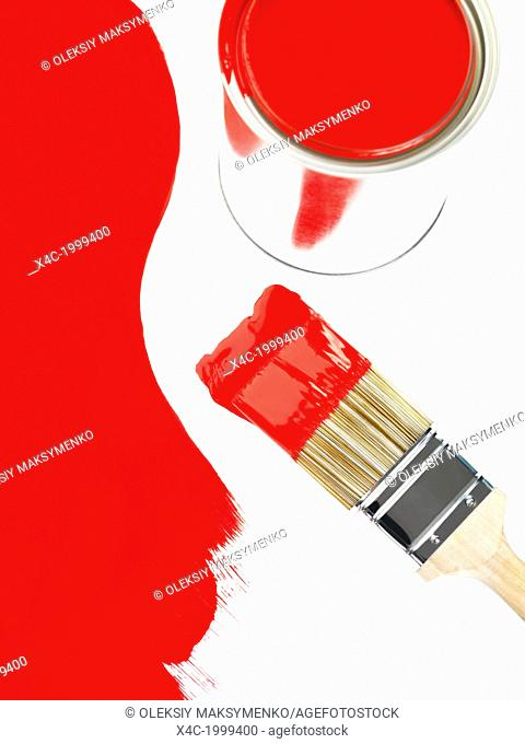 Open can of red pain and a paint brush artistic still ife. Painting and renovation concept