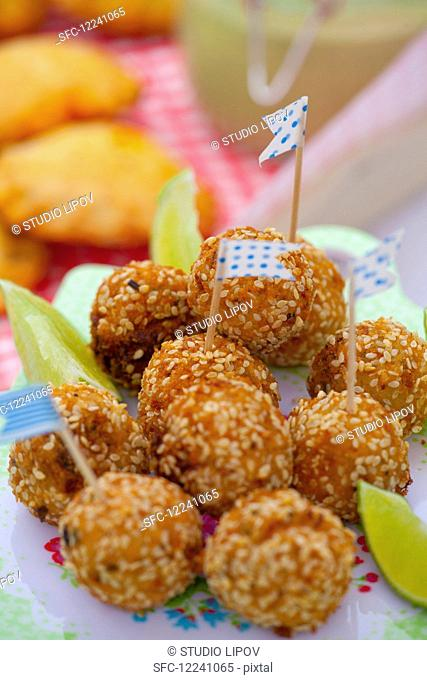 Fish balls with celery, onion and sesame for a picnic