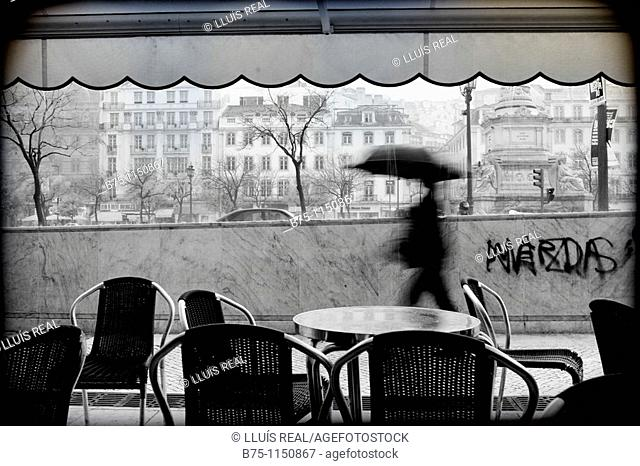 Lisbon, terrace of a bar, rainfall