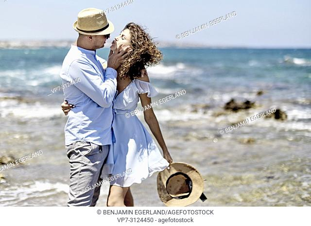 couple at beach in Hersonissos, Crete, Greece