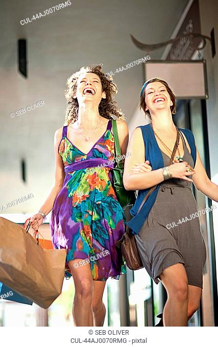 Smiling women shopping together