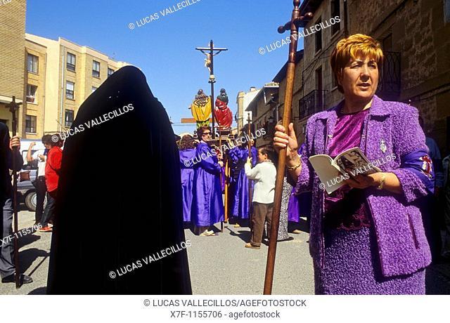 At left `Maria'female penitent 'Los Picaos',Holy Week procession  Cofradia de la Santa Vera Cruz de los disciplinantes  San Vicente de la Sonsierra, La Rioja