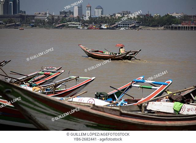 A long tail boat in the Irrawaddy River in Dala, Yangon, Myanmar