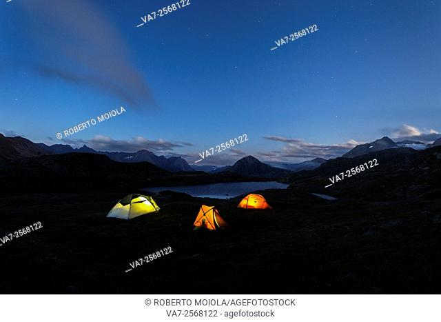 The soft lights of the tents light up dusk Minor Valley High Valtellina Livigno Italy Europe