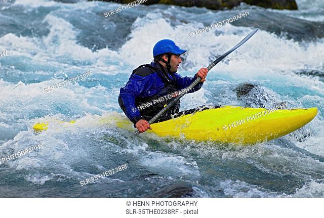 Man kayaking in white water rapids