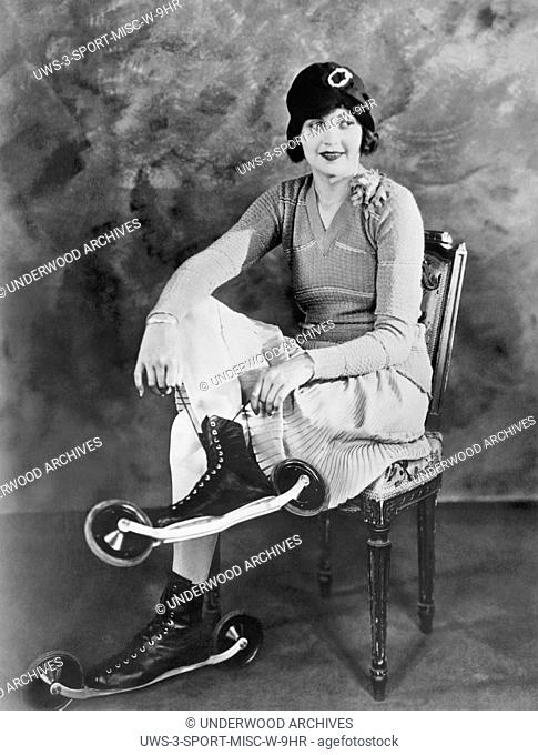 Hollywood, California: c. 1926.Silent film actress Lucille Hutton putting on her bicycle skates