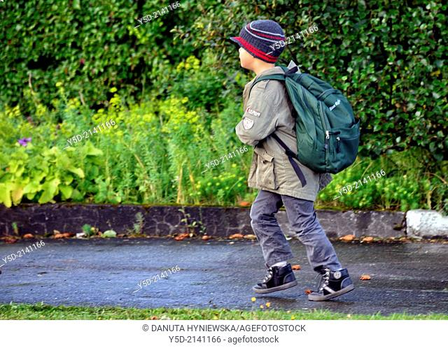 Little boy running to school in Reykjavik, Icelandic children are quite independent especially comparing to the rest of Europe