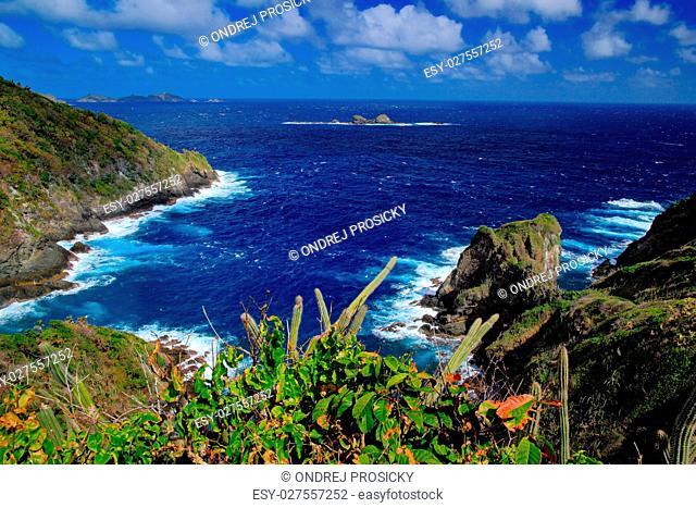 Little Tobago Island. Beautiful Caribbean sea coast landscape wi