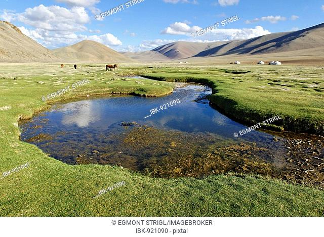 Valley with stream and yurts, Altai, Mongolia, Asia