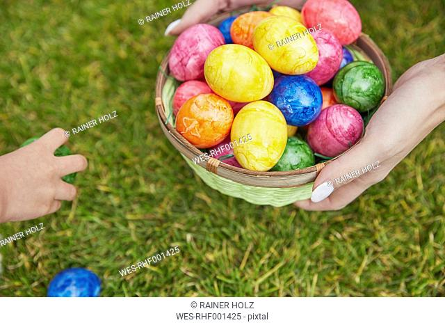 Easter basket with colourful eggs