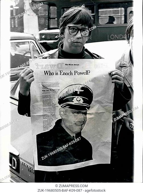 May 05, 1968 - Dockers Clash with Demonstrations: Photo shows A girl anti - racial demonstrator seen with an Enoch Powell banner - outside the House of Commons...