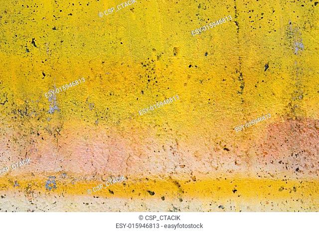 Grunge yellow painted wall