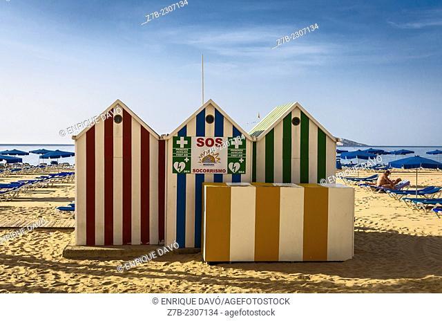 View of a colour cabins on the Benidorm beach, Alicante north, Spain