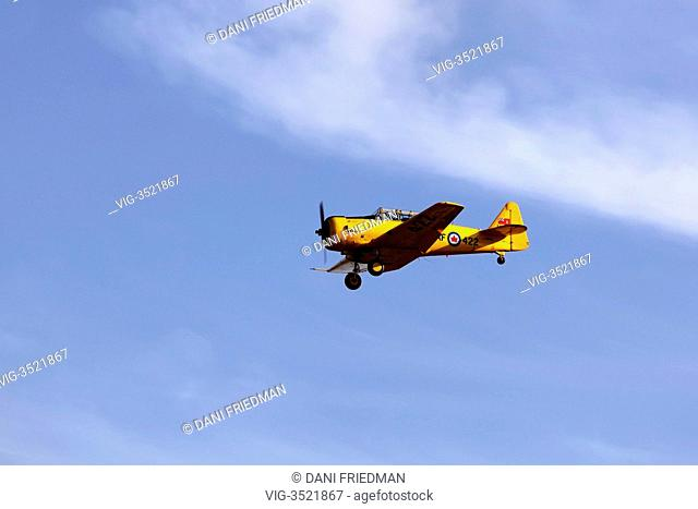 A Royal Canadian Air Force Harvard IV airplane in flight over Toronto, Ontario, Canada. - TORONTO, ONTARIO, CANADA, 01/09/2012