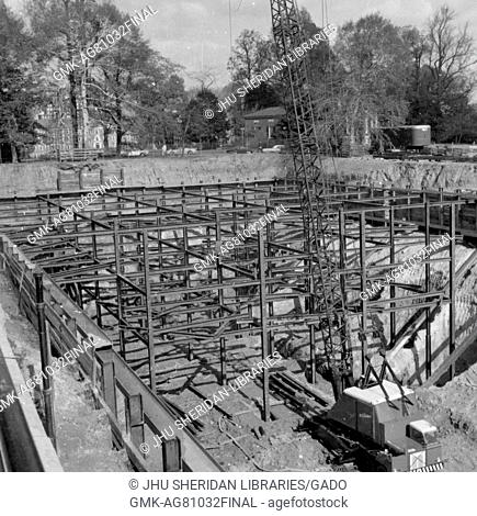 During the early stages of construction of the Milton S Eisenhower Library at Johns Hopkins University, steel beams are stacked and arranged to create the...