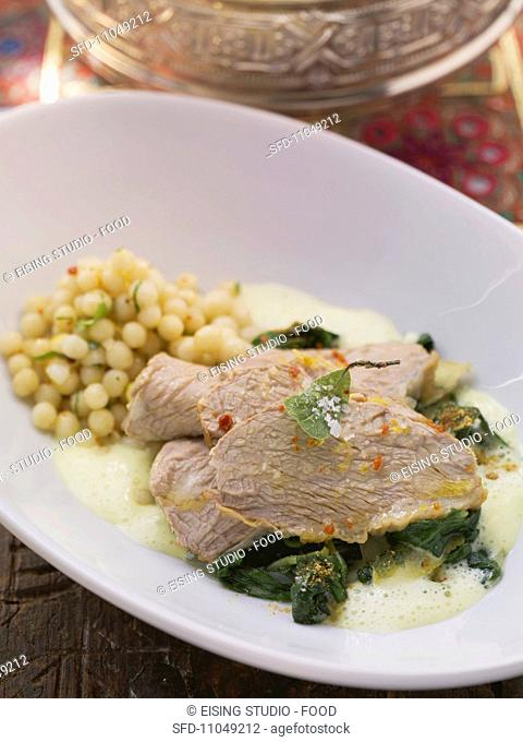 Prime boiled veal with spinach, turmeric and mustard foam and Lebanese couscous