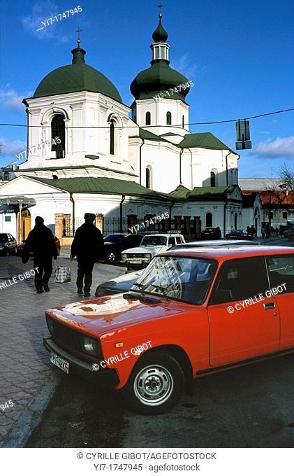 Ukraine, Kiev, Podil district, red Lada parked in the street