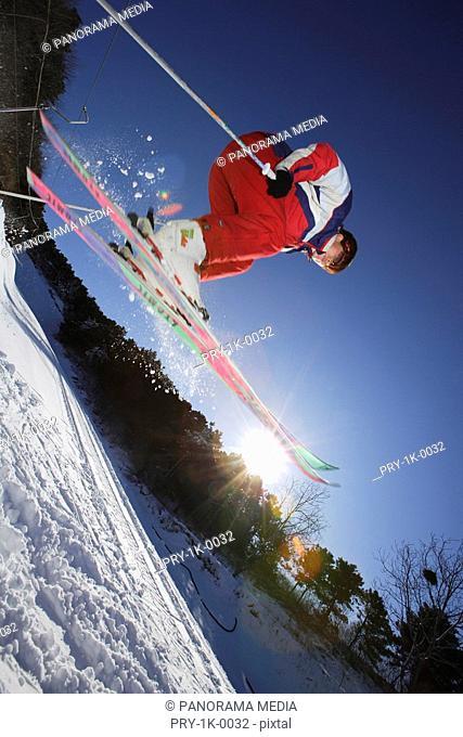 Skiing young man