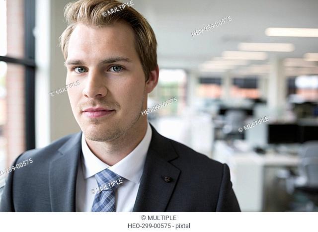 Close up portrait confident businessman in office
