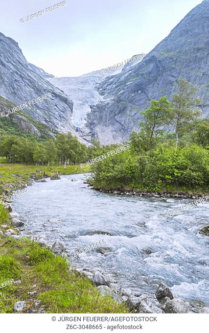 glacier Briksdalsbreen and its river below, Norway, Jostedalsbreen National Park in the valley Oldedalen, Olden at the Nordfjorden