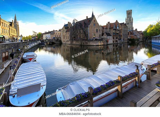The medieval City Centre Unesco World Heritage Site framed by Rozenhoedkaai canal Bruges West Flanders Belgium Europe