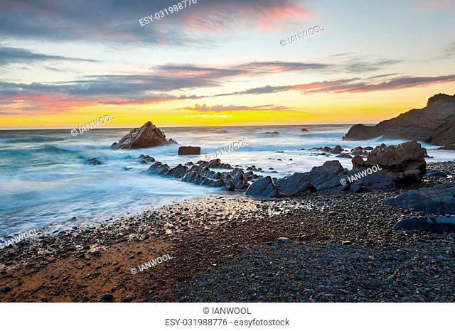 Dramtic sunset on the beach at Sandymouth near Bude North Cornwall England UK Europe