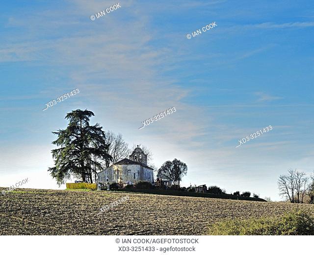 empty farm field and Saint-Macaire church, Lot-et-Garonne Department, New Aquitaine, France