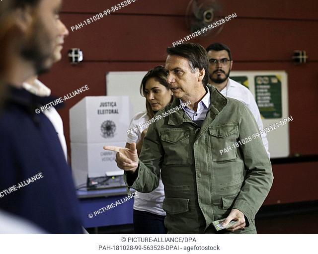 28 October 2018, Brazil, Rio de Janeiro: Jair Bolsonaro, ultra-right candidate for the office of Brazilian president, arriving to vote in a polling station