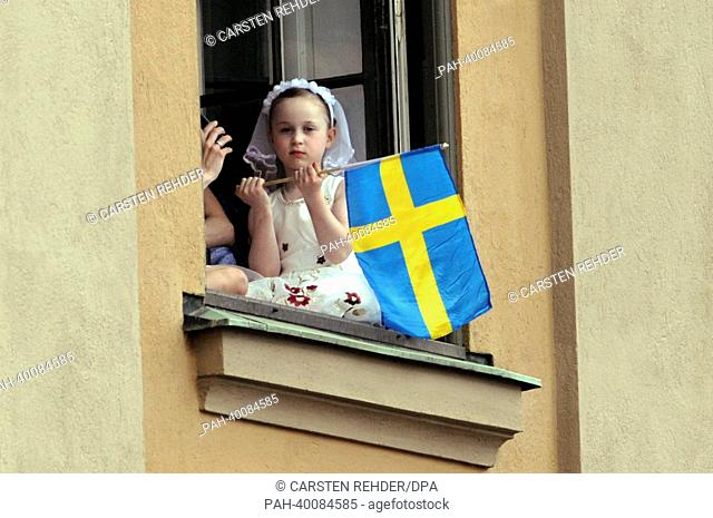 A litte girl waves a Swedish flag waiting for Swedish Princess Madeleine and her husband Chris O'Neill after their wedding in Stockholm, Sweden, 08 June 2013