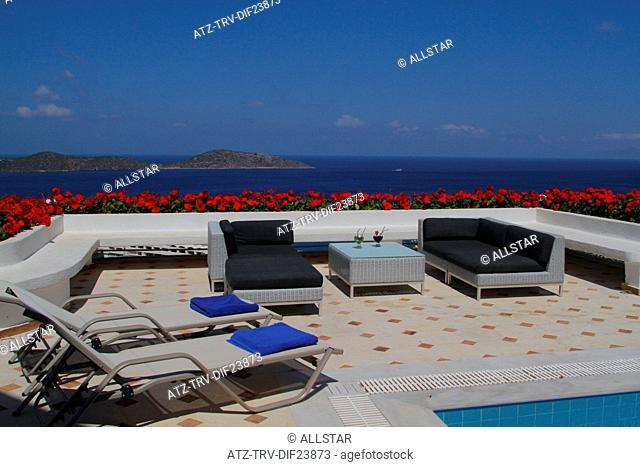 LOUNGERS & AEGEAN SEA VIEW; ELOUNDA, CRETE, GREECE; 07/05/2014