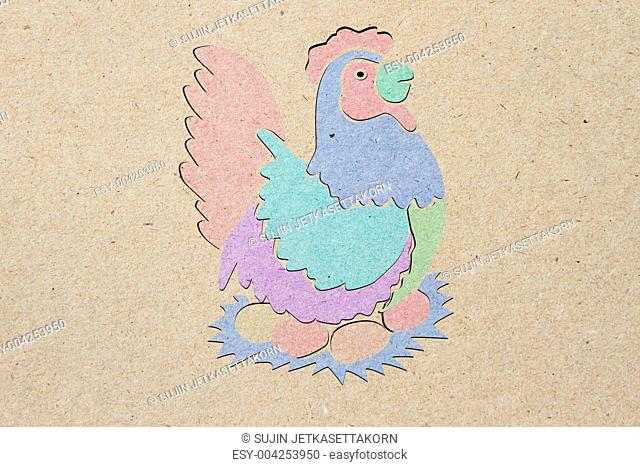 recycled paper craft stick, chicken, brown background